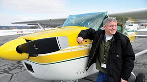 State pilot Guy Rouelle with his Cessna at Knapp Airport in Berlin