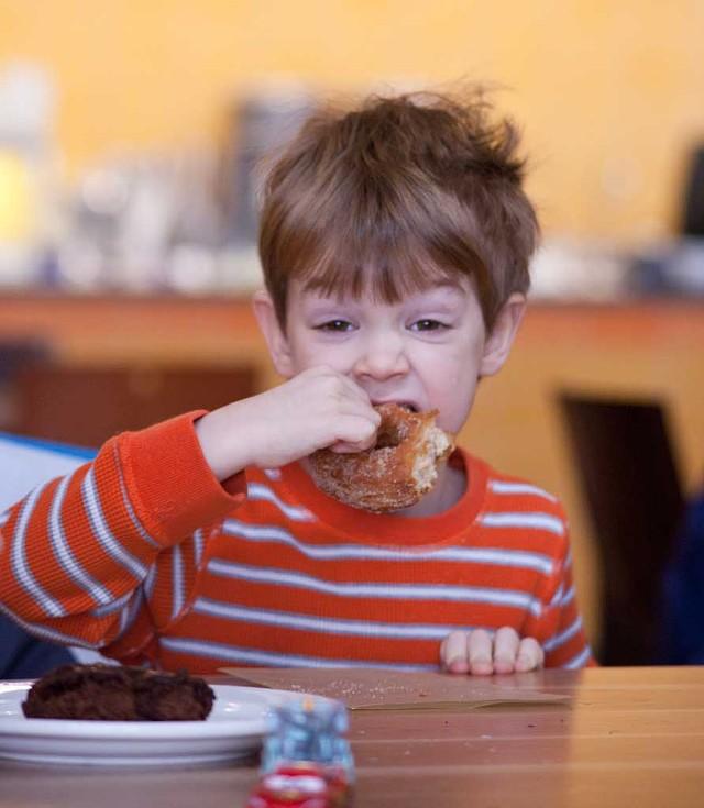 Steve Wisloski enjoys a doughnut - MATTHEW THORSEN