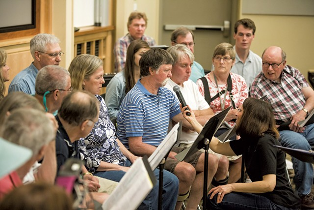 Stroke survivor Bob Smith speaks during a dress rehearsal of the Aphasia Choir - OLIVER PARINI
