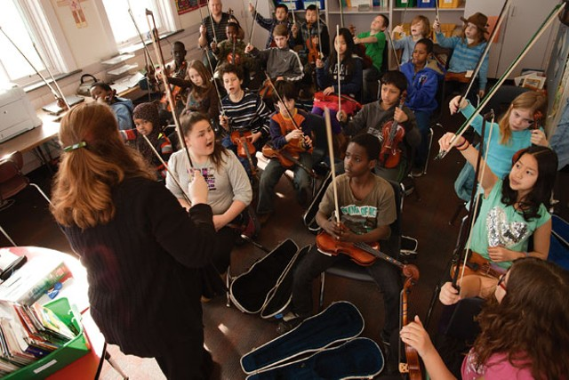 Students at IAA and their violins - MATTHEW THORSEN