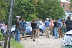 Students surround President Plunkett's car outside the Lake Champlain Chamber of Commerce. - ALICIA FREESE