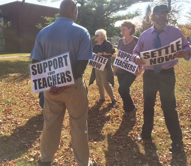 Teachers picket outside South Burlington High School Tuesday. - MARK DAVIS