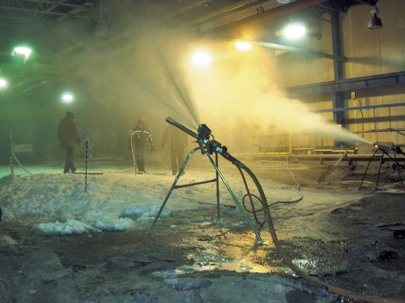 Testing snow guns at the Cold Regions Research and Engineering Laboratory - COURTESY OF CRREL