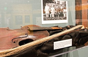 The inner chamber of the 1861 fiddle, on loan   from the barber at the university's barber shop,  is inscribed with Abraham Lincoln's name.