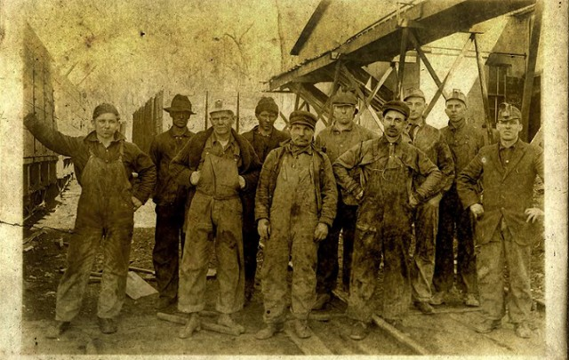 """Thomas Clarence """"TC"""" Chapman (second from right) with a group of Iowa coal miners - COURTESY JESSE KREITZER"""