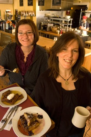 Tonya Calley and Carrie Ferguson with gingerbread waffles and creme brulée french toast at the Mix