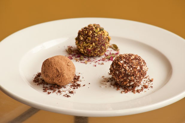 Trio of house truffles: cardamon rose pistachio, cacao nib and toasted coconut, and cocoa powder - MATTHEW THORSEN