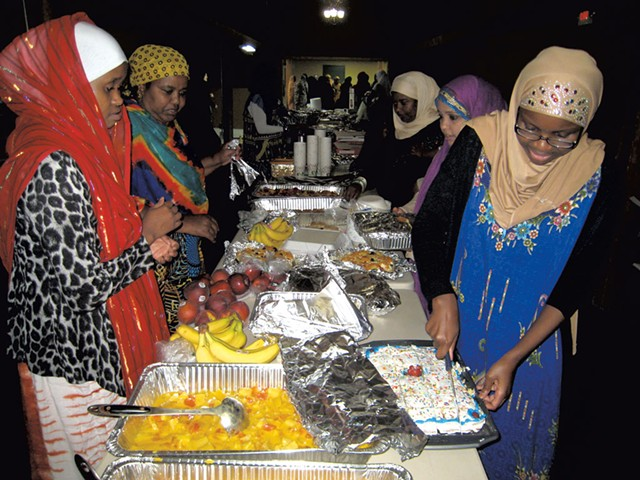Hawa Adam (right), organizer Luley Amir (second from left) and other iftar attendees - KYMELYA SARI