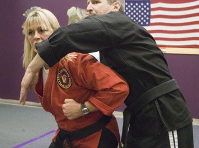 Laurie Shover with Rick Massar at Villari's Self-Defense & Wellness Center - MATTHEW THORSEN