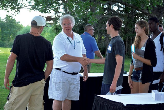 David Wolk greeting students at a barbecue on campus - TEARSA BRANNOCK