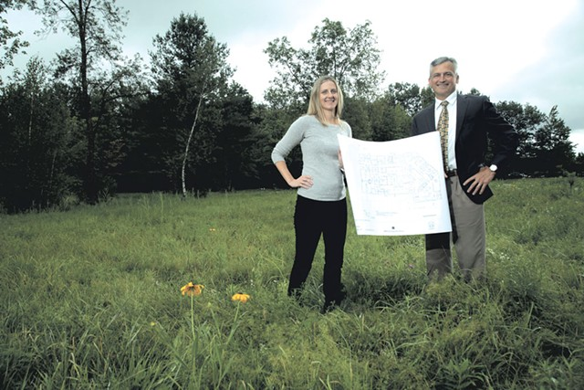 Amy Cooper and Dr. Tom Dowhan at the  site of the proposed surgical center - MATTHEW THORSEN