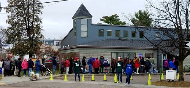 Waiting in line for turkeys at the Chittenden Emergency Food Shelf - ANNA MCMAHON/FOOD SHELF
