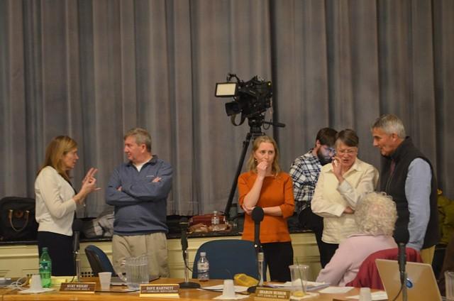 Councilors conferring during recess - KATIE JICKLING