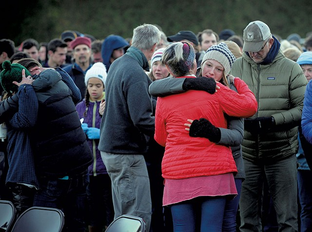 Mourners embracing during a vigil at Harwood Union High School for the teenagers killed in the 2016 crash - FILE: STEFAN HARD