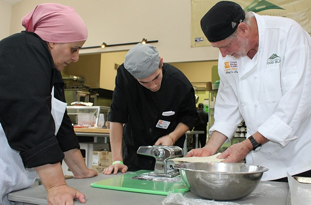 Community Kitchen Academy chef Jim Logan (right) with students - COURTESY OF COMMUNITY KITCHEN ACADEMY