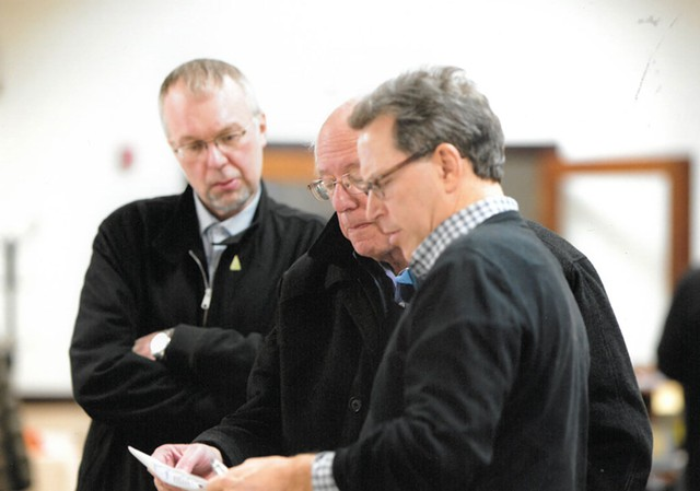Phil Fiermonte shows Sen. Bernie Sanders and son Levi Sanders results from New Hampshire's February 2016 Democratic presidential primary in Concord, N.H. - COURTESY: PHIL FIERMONTE