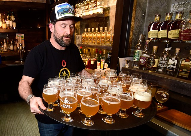Ari Fishman delivering a tray of Zero Gravity beer - JEB WALLACE-BRODEUR