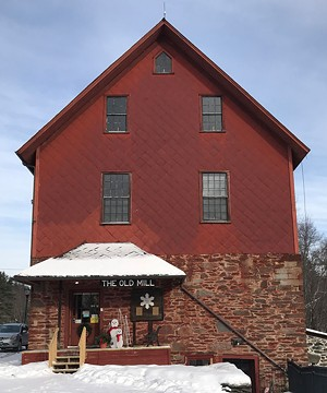The Old Red Mill on Route 15, site of the Jericho Historical Society - SUZANNE M. PODHAIZER