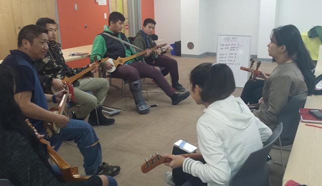 Migmar Tsering (far left) and his students. - KYMELYA SARI