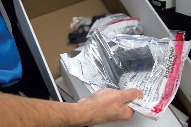 A gun stored in the critical evidence locker at the Colchester Police Department - JAMES BUCK