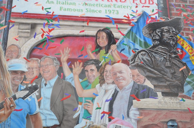 """Miro Weinberger, with his daughter Li Lin sitting astride his shoulders, in the """"Everyone Loves a Parade"""" mural - KATIE JICKLING"""