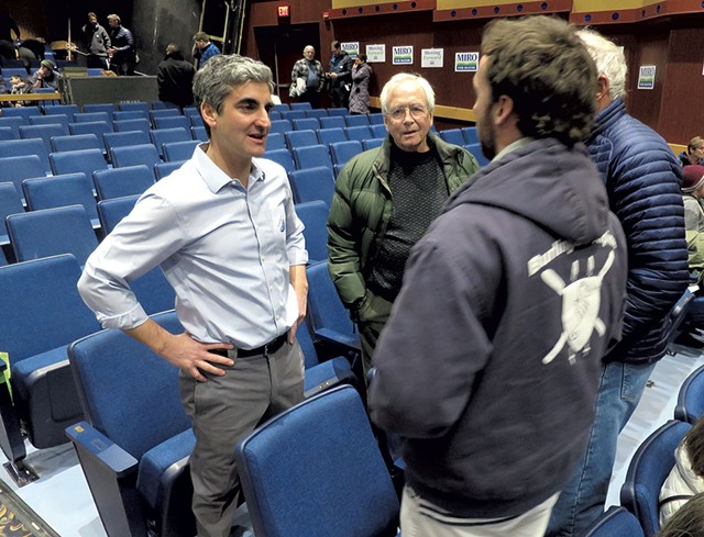 Mayor Miro Weinberger talking with constituents at the Democratic Caucus - MATTHEW THORSEN