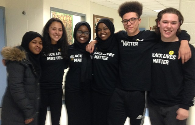 Members of the Burlington High School Social Justice Union celebrate. From Left to right: Binti Malawia, Marissa Cobeo, Hawa Adam, Balkisa Abdikadir, Rivan Calderin and Eli Pine - MOLLY WALSH