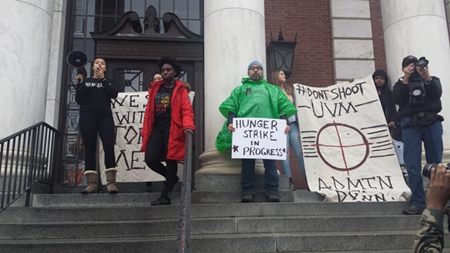 UVM students and John Mejia (in green) outside the Waterman Building - KYMELYA SARI