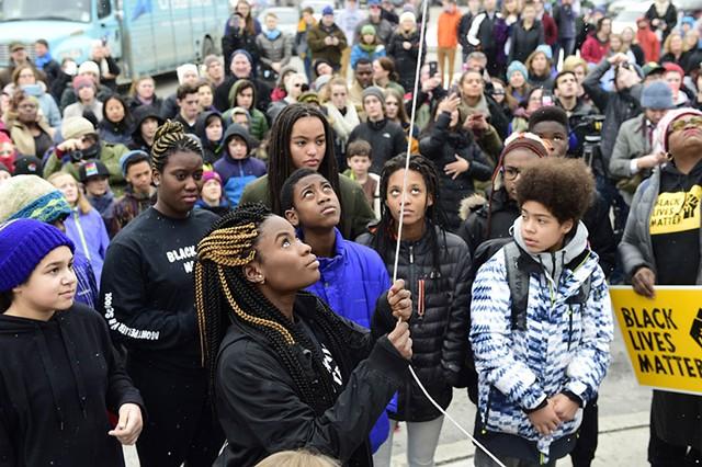 Joelyn Mensah raising the Black Lives Matter flag at Montpelier High School - FILE: JEB WALLACE-BRODEUR