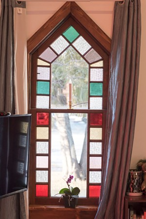 One of the home's stained-glass windows - CALEB KENNA