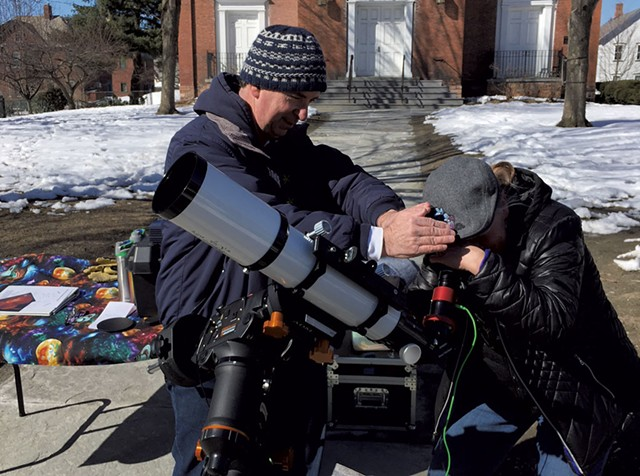 Tim Connolly helping someone look at the sun - COURTESY OF JACK ST. LOUIS