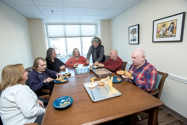 Residents at Memory Care at Allen Brook making bird feeders - COURTESY OF KAREN PIKE