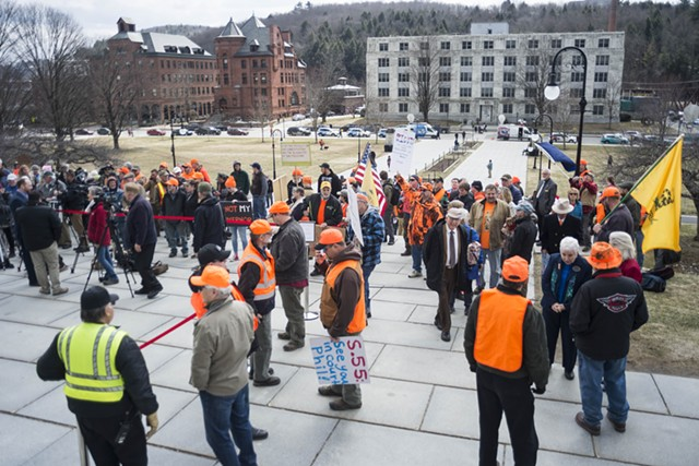 Citizens opposed to the new gun legislation gather at the Statehouse before last Wednesday's ceremony. - FILE: JOSH KUCKENS