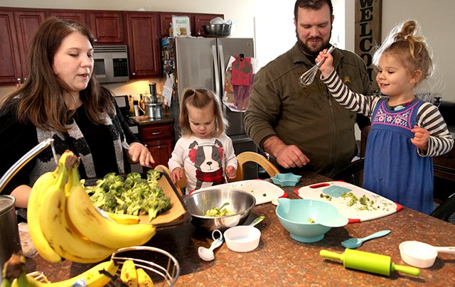 Joanna, Bree, Jake and Genevieve Scott preparing dinner together - MATTHEW THORSEN