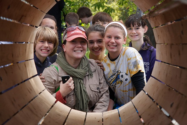 Former Milton teacher Joanna Scott poses for a photo with students in her Healthy Living class at MR Harvest Farm in South Hero during a field trip in October 2013. - COURTNEY LAMDIN / MILTON INDEPENDENT