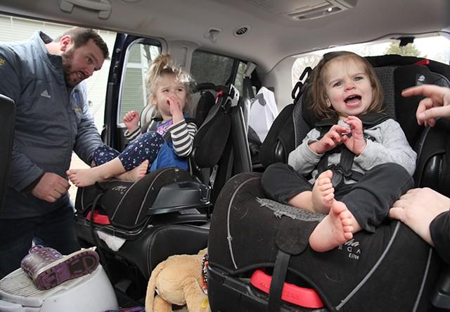Jake, Bree and Genevieve Scott piling into the car - MATTHEW THORSEN
