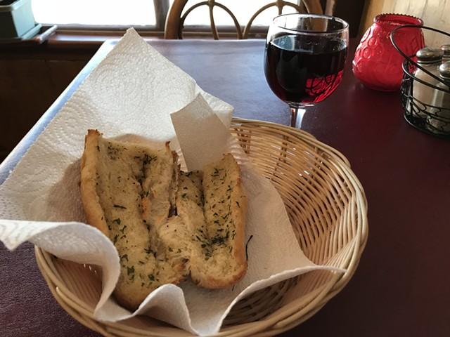 Garlic bread and wine at Papa Frank's - SALLY POLLAK