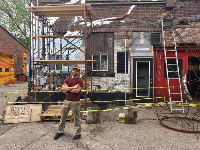 Aaron Grossman with mirror mural-in-progress - SADIE WILLIAMS