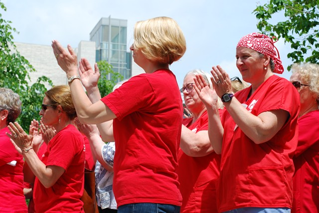 Nurses clapping at Friday's press conference - SARA TABIN