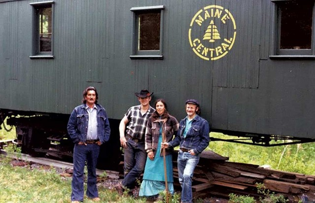 Hood River Blackie; Feather River John; John's then-wife, Alice; and Hot Shot Timer in front of an old Maine Central caboose in McClaughry's yard circa 1974 - COURTESY OF JOHN MCCLAUGHRY