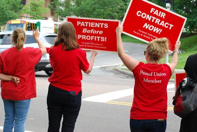 Nurses at a honk-and-wave rally outside the hospital - SARA TABIN