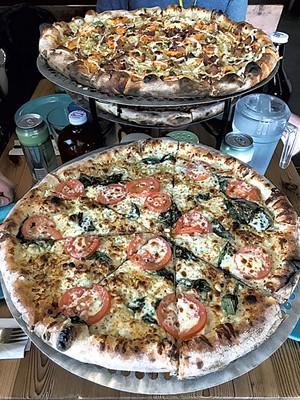 Folino's pizza - SALLY POLLAK