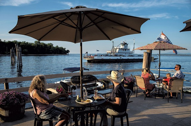 Patrons on the deck of the Old Dock Restaurant & Marina watching the arrival of the ferry - GLENN RUSSELL