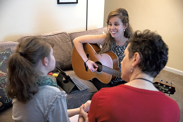 Marcie Hernandez (center) conducting a session with Hannah Waterman (left) as personal care assistant Stephanie Shohet helps out - JAMES BUCK
