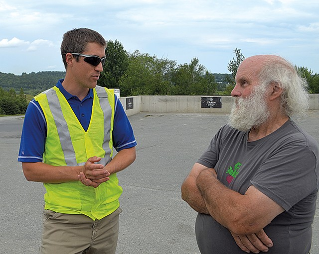 Landfill general manager Jeremy Labbe (left) speaking with Chris Jacobs - MOLLY WALSH