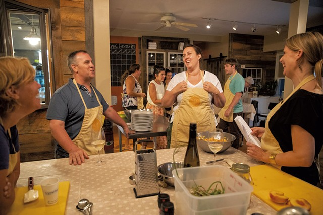 Chef Cara Chigazola Tobin (center) with students before dinner - JAMES BUCK