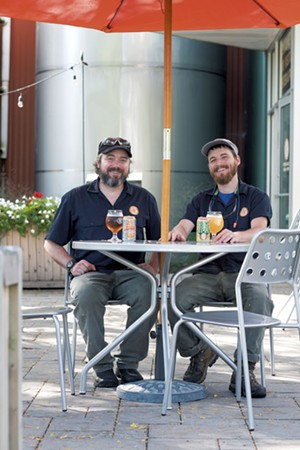 Otter Creek Brewing head brewers Nick Smith (left) and Robbie Leeds - CALEB KENNA