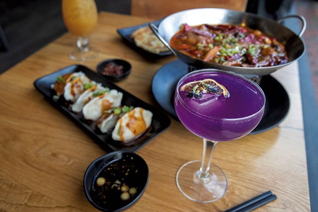 House cocktail with butterfly pea flower, Mongolian lamb with hot chile, scallion pancake and Sichuan spicy dumplings at Mandarin in Winooski - JAMES BUCK