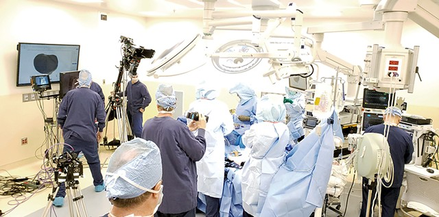 A film crew shooting Dr. Bryan Huber in surgery - COURTESY OF VARISES
