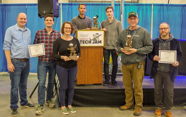 Tech Jam and Reverse Pitch award winners, L to R: Ben Corneau and Evan Gould of Code Shepherd (not pictured: Corey Andalora, Dave Davis and Adam Burnett); Maureen McElaney; Ben Boas and Alex Horner of Burlington Code Academy (not pictured, Alex Chafee); Gary Margolis, founder of Social Sentinel; Jake Blend of Learning Portals - STEPHEN MEASE